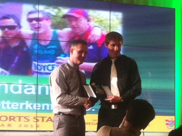 Walker Brendan Boyce receives his award