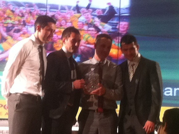 Rory Kavanagh, Karl Lacey and Frank McGlynn accept the team award on behalf of the Donegal GAA team