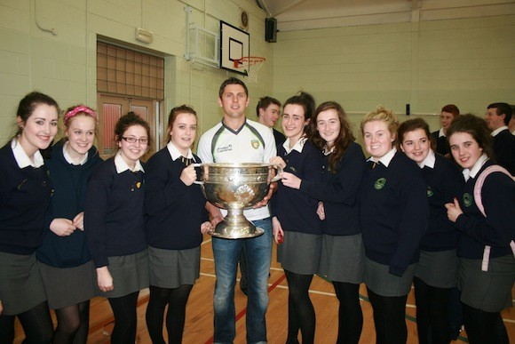 Current  and past pupils of Crana College pictured with Sam Maguire