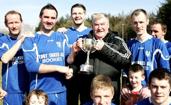 Donegal Junior League Administrator Terry Leyden pictured presenting the Glencar Inn Saturday Division Two League Trophy to Gary Crawford captain of Deele Harps who secured the title on Saturday with victory over Keadue Rovers Reserves