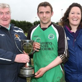 Donegal Junior League Administrator Terry Leyden pictured presenting the Downtown Cup to Tommy Rodgers captain of Glenea United Reserves. Included is League Secretary Christina O