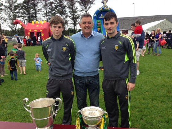 Donegal Minor starlets Adam Neely and John McDyer show former Premier League manager Owen Coyle their Ulster Minor Title and the Anglo Celt cup in Dungloe earlier today.