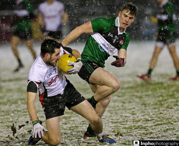 Mark McHugh battles for possession in the snow during their superb extra-time win over Queen's University Belfast last night.