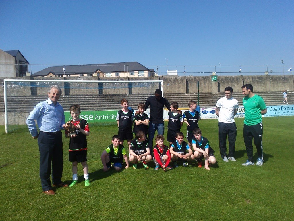 Winning boys team along with Paddy Harte (chairman); Mel O'Donnell (teacher); Wilfred Tsgabo & Ciaran Coll (Finn Harps Players)