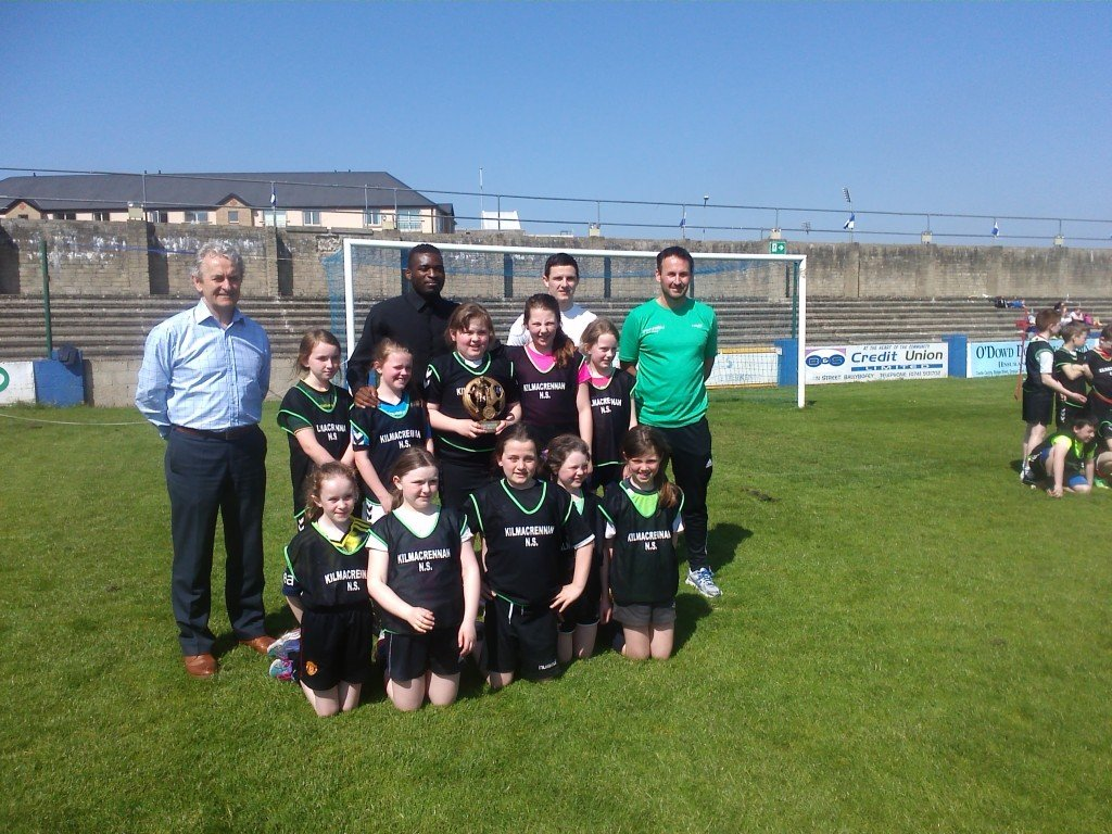 Winning girls & boys team along with Paddy Harte (chairman); Mel O'Donnell (teacher); Wilfred Tsgabo & Ciaran Coll (Finn Harps Players)