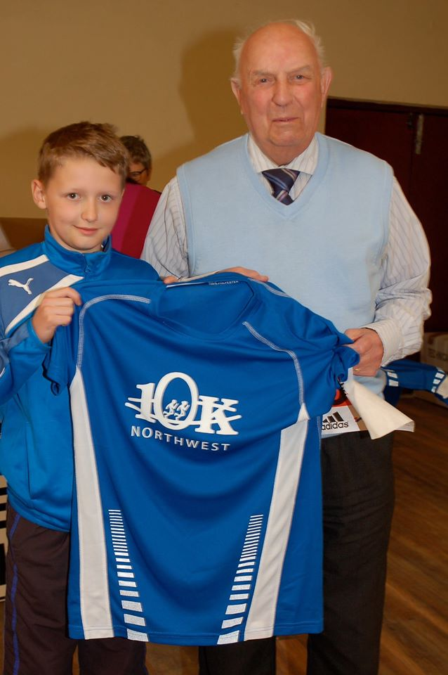 Dermot Hannigan with his grandson Liam McKinney signing on for the North West 10K and proving it spans the generations.