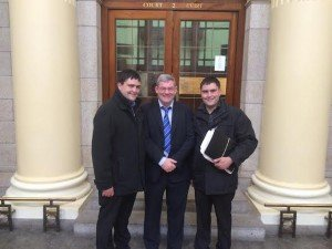 Journalist CJ McGinley with sons Patrick and Shaun outside the High Court in Dublin today.