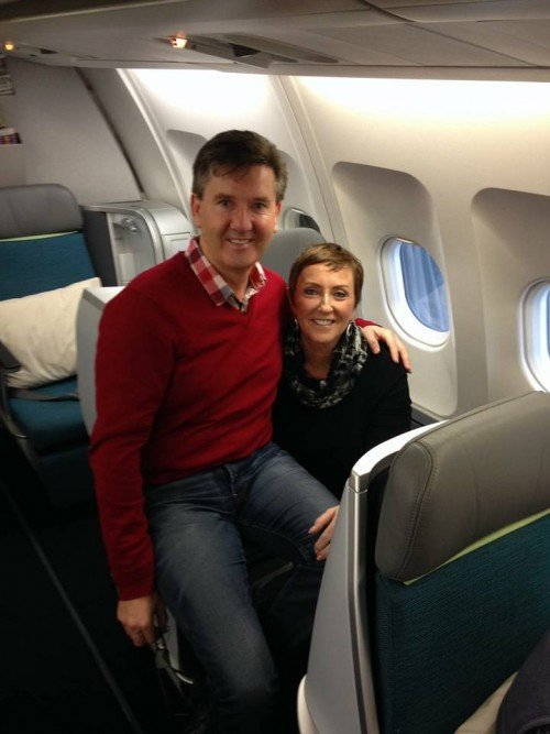 Daniel and Majella on board the plane taking them from Dubliln to LA to start their world cruise