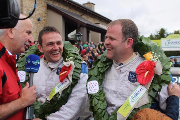 Manus Kelly (right) with co-driver Donal Barrett after winning last year's National event.