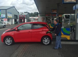 Brendan, our friendly petrol pump attendant keeps a straight face as he fuels up our badly parked Toyota Aygo at Tobin's filling station. Photo Brian McDaid