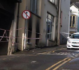 Gardai at the scene of this morning's blaze in which up to eight cars were damaged. Pic by Northwest Newspix.
