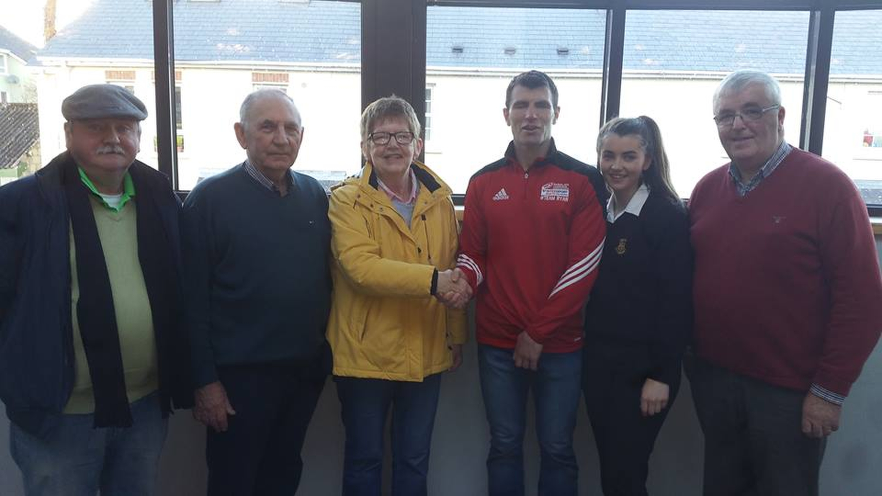 Ita Daly who was the lucky winner in the Letterkenny Credit Union Draw. pictured as she is congratulated by Danny Ryan who made the presentation pictured with members of the Letterkenny Credit Union board.