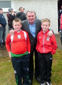Ray Houghton pictured with Keadue Rovers underage players when he visited the county in 2012.