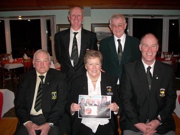 Front Row Past President Wm Mc Cleary, President Kathleen Mc Cormick, Past Captain D P Logue. Back Row Captain Joe Harkin, & Paid MC Menemin who accepted the prize on behalf of Portsalon Golf Club.