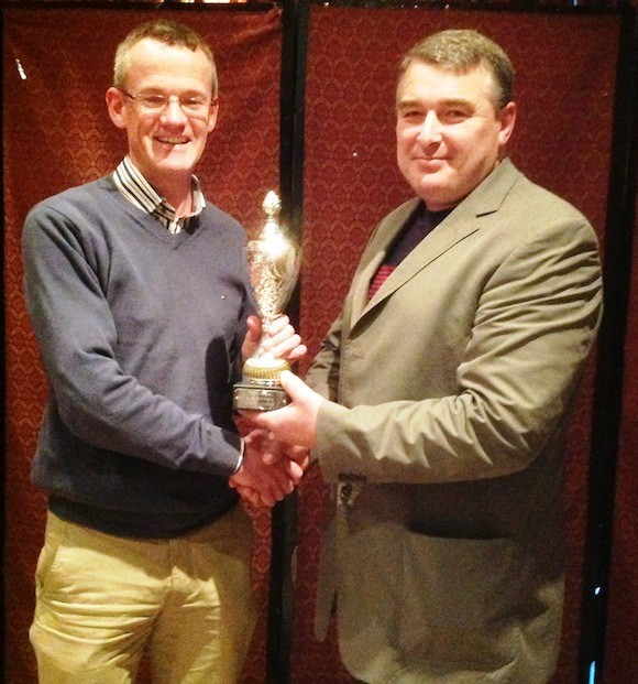 Club person Richard McCarthy[left] receives award from club chairman Paul OGara
