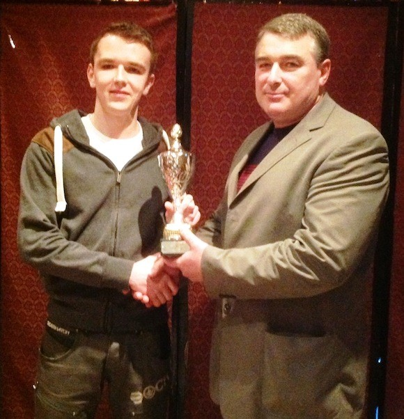 Overall Boy Karl Griffin receives award
