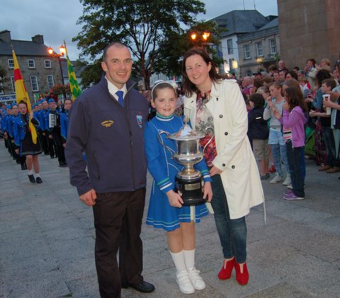Catlyn Duffy with the All Ireland Cup and two of the founding members of the band; Pauric Kennedy and Linda O'Donnell