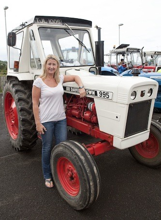 Patricia Hill of Stateside Restaurant, Letterkenny stops for a quick pic during the Drumoghill NS Tractor Run.