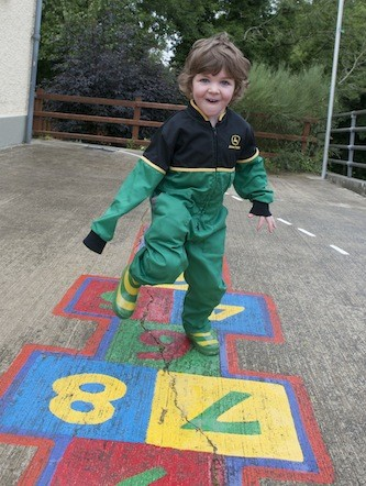 Young Oisin Higgins all suited and booted for the Drumoghill NS Tractor Run.