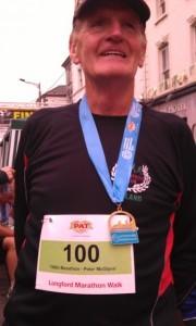 Peter celebrates with his 100th marathon medal!