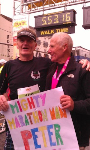 Peter celebrates with his friend Seamus Temple at the finish line today.