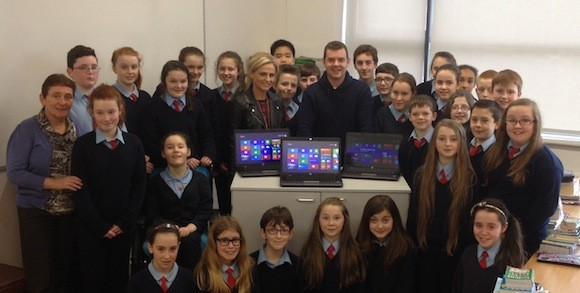 Danny and Amanda O'Carroll with principal Anne Foxe and pupils.