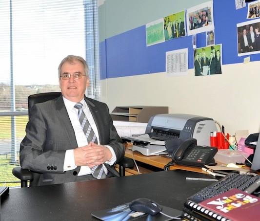 Aidan at his desk