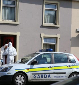 Forensic experts carry out their investigations at the house were the young man died.