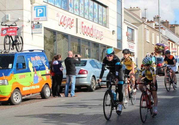 Philip Deignan cycles down Dungloe Main Street
