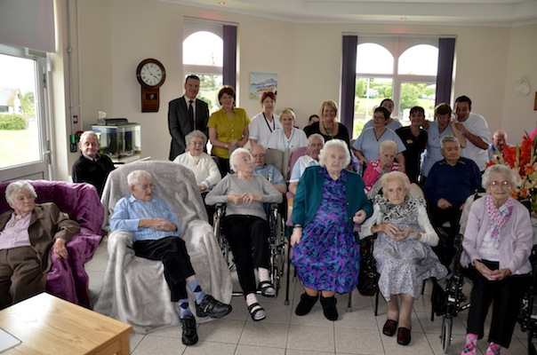 Residents and staff in the newly refurbished 'Rosses Sitting Room'.