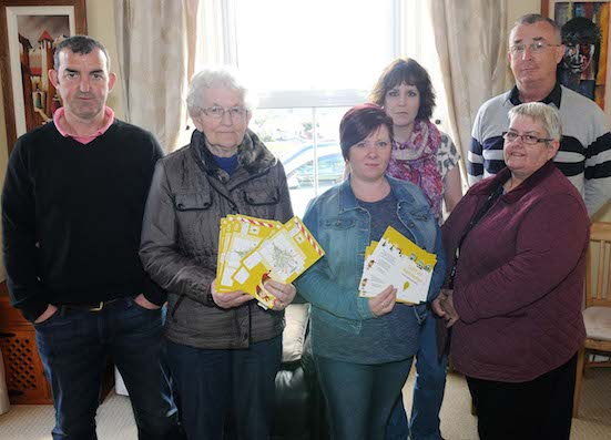 Dessie McLaughlin, Mary McAteer, Moira McHugh, Tracey Buchanan, Bernie Kane and Fr. Martin Collum from the Rathmullan Lights Committe launching their Stamps initiative this week. Pic by Francis Diver.