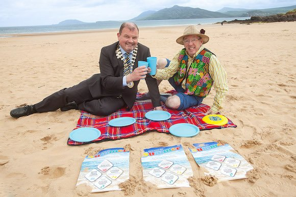 Life's a beach! Chairman of Donegal County Council, Cllr Ciaran Brogan with comedian Conal Gallon waiting for this week's heatwave.