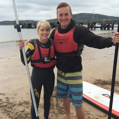Luke Daly shows TG4 how to paddle board.