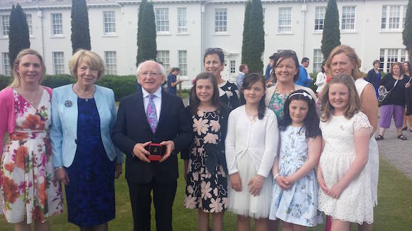 Volunteers and founding members of the Childhood Cancer Foundation pictured at the President's Summer Garden Party were from left: Virginia Murray, Mrs Sabine Higgins, President Michael D Higgins, Ciara Murray, Niamh Richard, Emer Toner and Alice Rennick. Back row from left: Maura Toner, Aine Richard and Mary Claire Rennick.