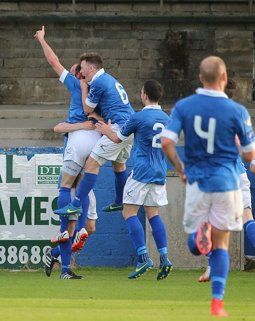 Funston is surrounded by his team-mates after scoring his latest screamer! Pic by Northwest Newspix.