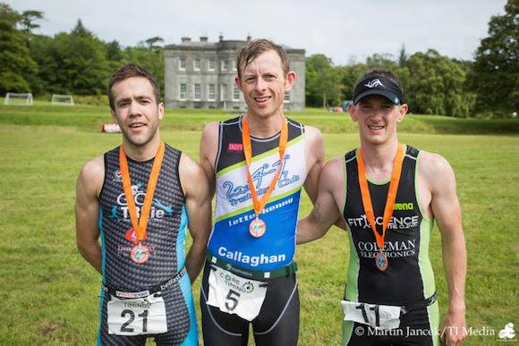 Aidan Callaghan (centre) wins the Lisaddell Triathlon.