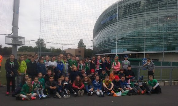 The first year students of Crana College with their teachers at the Aviva Stadium.