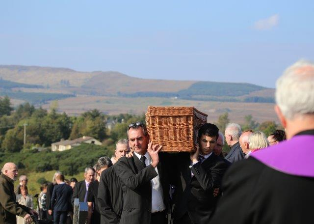 Mr Friel's remains are carried put to his final resting place at Glenties graveyard. Pic by Northwest Newspix.