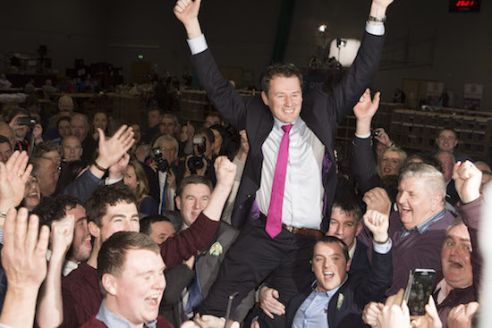 A jubilliant Charlie McConalogue is raised by supporters after he reclaimed his seat in Donegal. (North West Newspix)