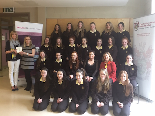 Ms Hennigan's class being presented with the winning prize from the Association of Geographic Information along with staff members from Donegal County Council.