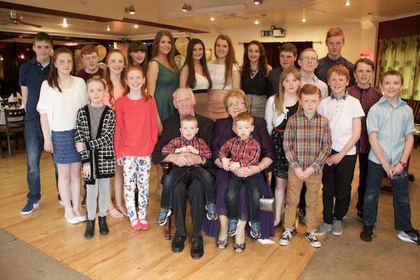 John and Betty Harkin with their 21 grandchildren on the occasion of their 50th wedding anniversary.