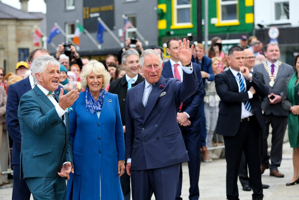 25/05/2016 NO REPRO FEE, MAXWELLS DUBLIN, IRELAND Visit to Ireland by The Prince of Wales and the Duchess of Cornwall. Donegal, Ireland. Pic Shows: Mr. Noel Cunningham, Television personality and Donegal Tourism greeting HRH The Prince of Wales and the Duchess of Cornwallas they arrive in Donegal Town. PIC: NO FEE, MAXWELLPHOTOGRAPHY.IE