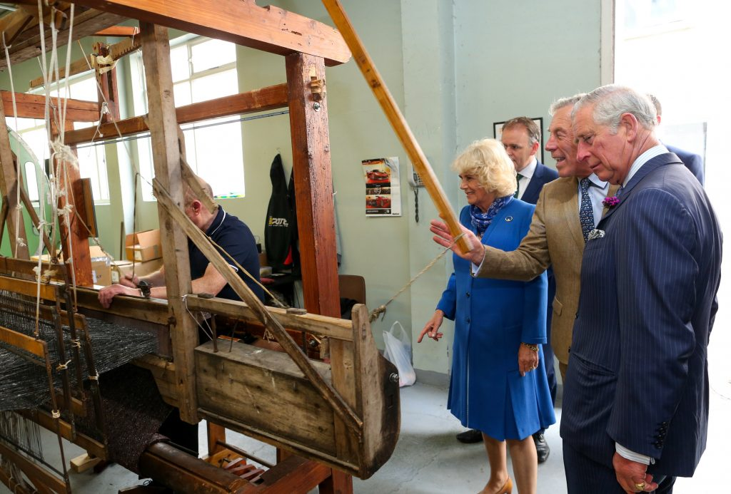 25/05/2016 NO REPRO FEE, MAXWELLS DUBLIN, IRELAND Visit to Ireland by The Prince of Wales and the Duchess of Cornwall. Donegal, Ireland. Pic Shows: HRH The Prince of Wales and the Duchess of Cornwall being shown how the tweed is made with Mr. Lynn Temple, Proprietor and Director at Magee of Donegal Tweed Workshop and Factory. PIC: NO FEE, MAXWELLPHOTOGRAPHY.IE