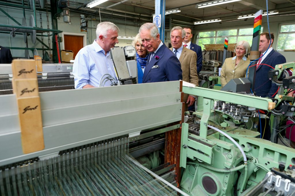 25/05/2016 NO REPRO FEE, MAXWELLS DUBLIN, IRELAND Visit to Ireland by The Prince of Wales and the Duchess of Cornwall. Donegal, Ireland. Pic Shows: HRH The Prince of Wales and the Duchess of Cornwall being shown how the tweed is made with Mr. Lynn Temple, Ms. Elizabeth Temple and Mr. Patrick Temple Proprietors and Directors at Magee of Donegal Tweed Workshop and Factory. PIC: NO FEE, MAXWELLPHOTOGRAPHY.IE