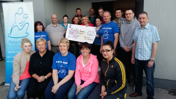 The Bonagee Fun Weekend committee present the cheque to Danny Devlin of Pieta House.