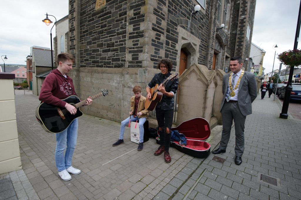 John Pat McDaid watching Nineteen 80 Something , DAvid Doherty, Emett O'Neill and Jamie Boner taking part in the Letterkenny Chamber Shop LK busking Competition in Letterkenny on Saturday last.  Photo Clive Wasson