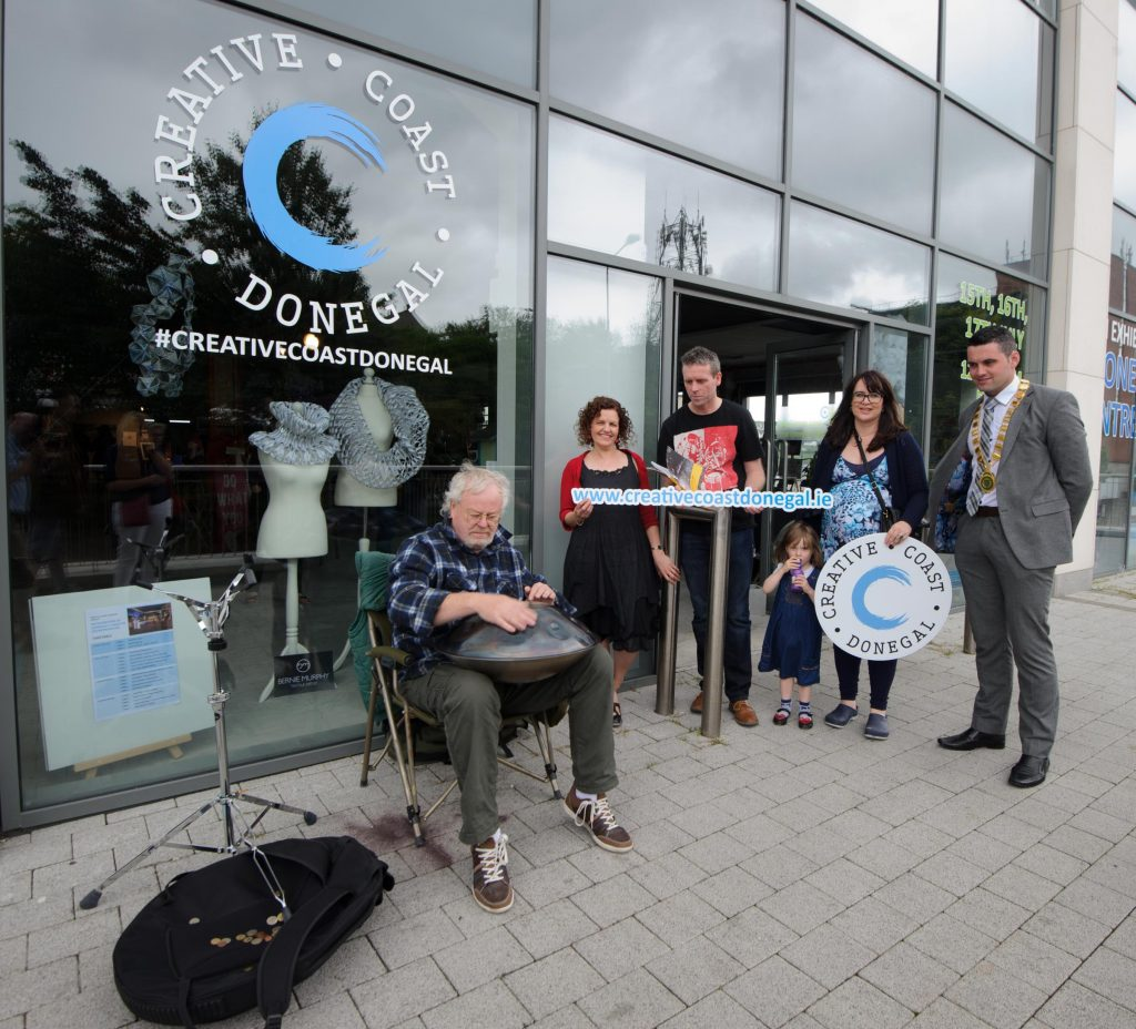 Harald Jungst,playing a hand pan for Fiona Higgins, Liam Porter,  Grace Corbel, LEO and John Pat McDaid as he is taking part in the Letterkenny Chamber Shop LK busking Competition in Letterkenny on Saturday last.  Photo Clive Wasson