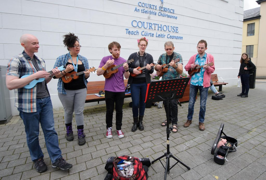 Anthony Cauldwell, Finn Blache, Ineke Abbas, Donal Kavanagh, Kieran Devlin and Conor Sweeney taking part in the Letterkenny Chamber Shop LK busking Competition in Letterkenny on Saturday last.  Photo Clive Wasson
