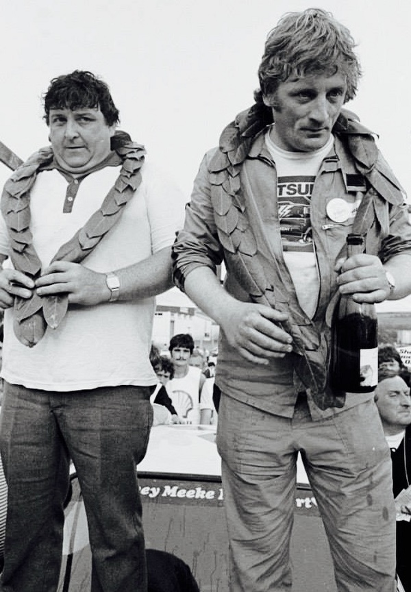 Meeks's first Donegal local heroes Vincent Bonnar and Seamus Mc Gettigan celebrate the win on the on the bonnet of their Ford Escort in '83. On the windscreen behind them Sydney Meeke, ,Kris Meeke fathers name is proudly on display, It also was his first Donegal win as a rally car specialist.