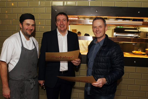 Mark Doherty with special guest Highland Radio's John Breslin and head chef Mark Greer at the opening of back stage in Letterkenny. Photos Brian McDaid